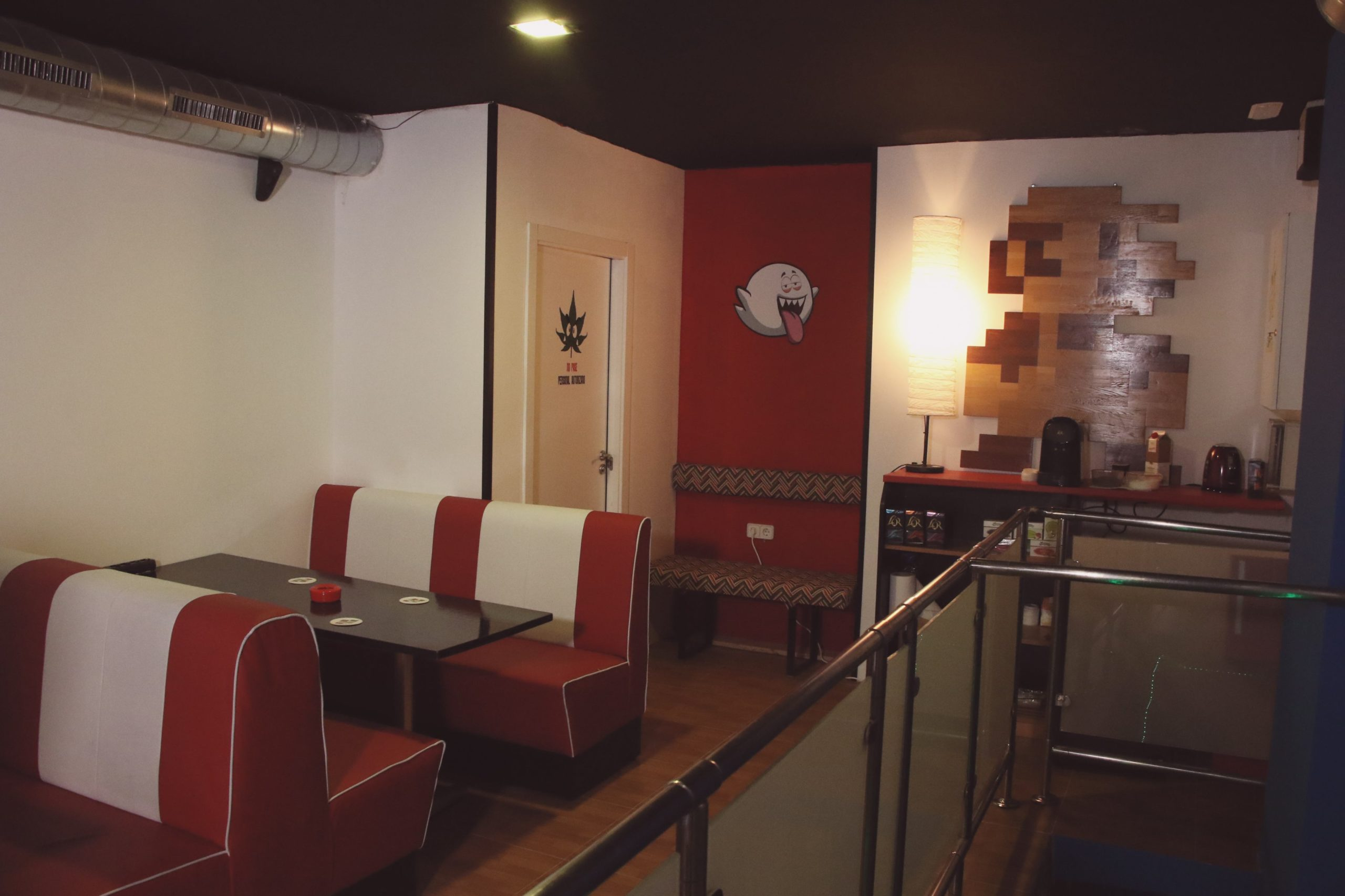 room decorated with video games theme with booths and tables
